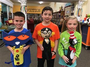 students who created soda bottle book characters