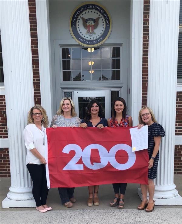 The fourth grade teachers at East Elementary are pictured with the Bicentennial flag.