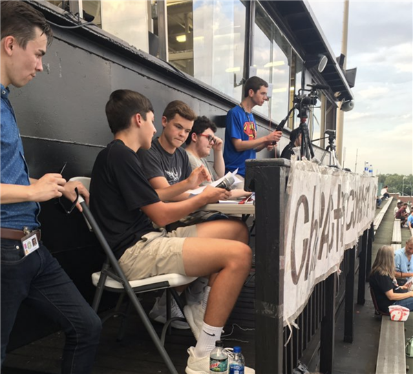 students broadcasting football game for Bearcat News Network