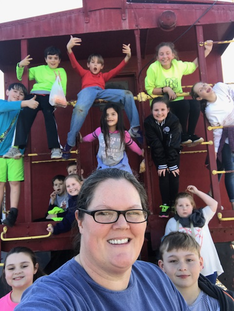 Picture of Mrs. Milne with extended day students